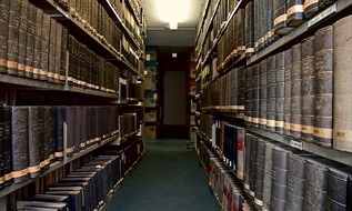 Old books on library shelves